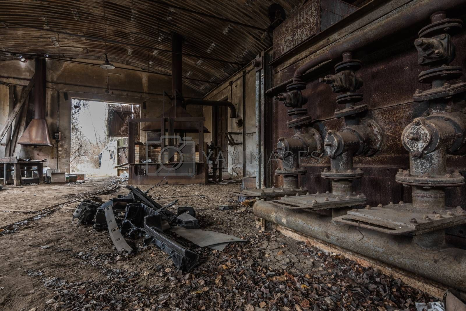 dark hall with rusty pipes of a factory