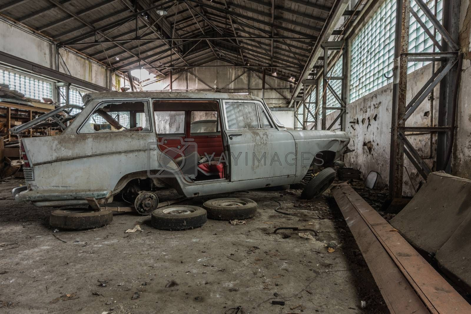 Disassembled car in a hall side view