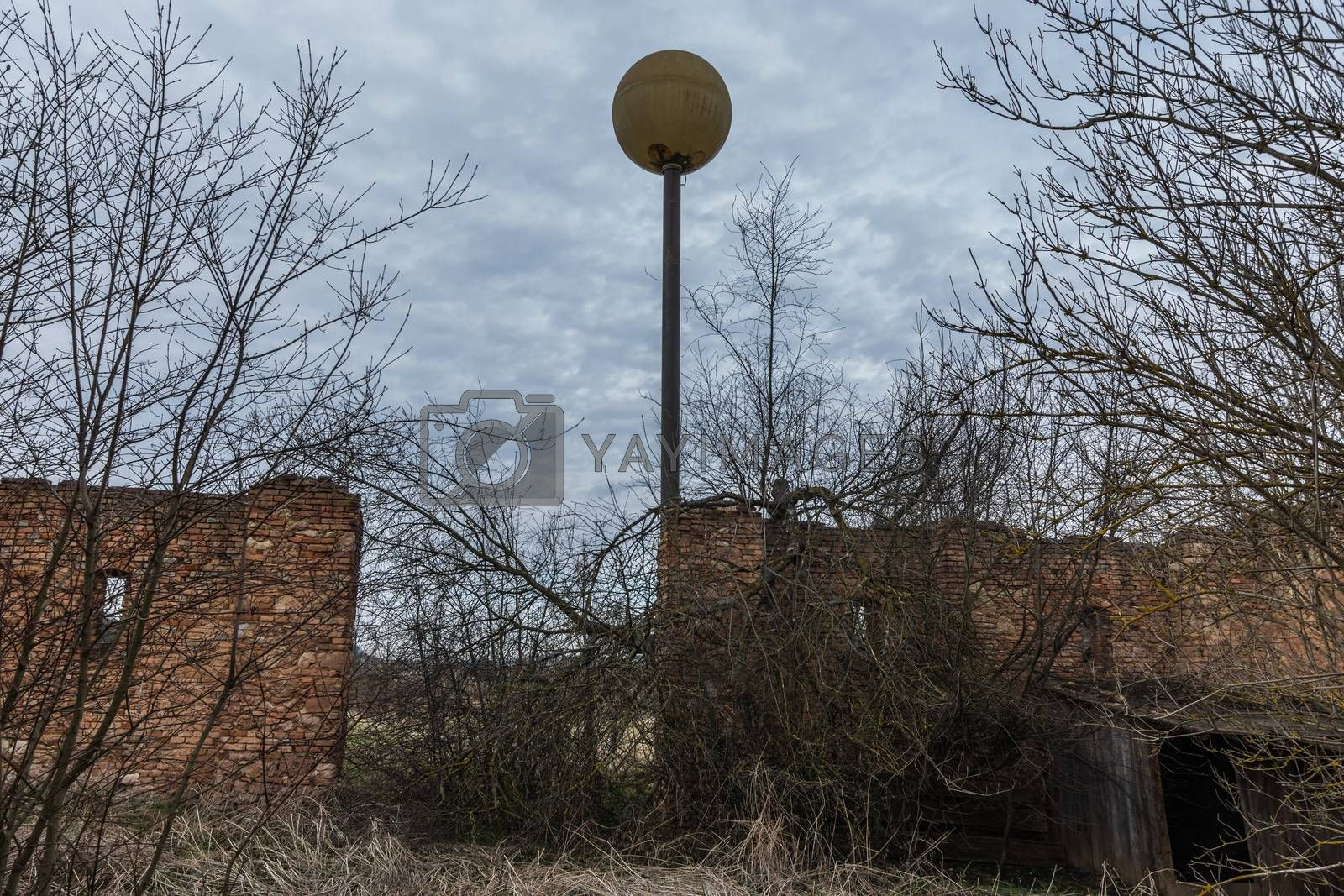 high round lantern with a wall in nature