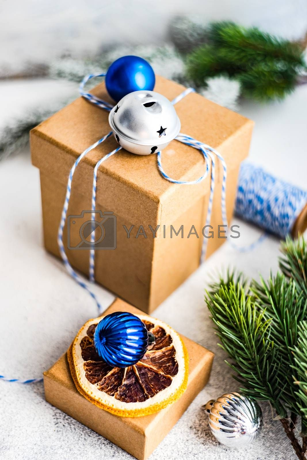 Christmas card concept with gift boxes decorated with ribbon and baubles