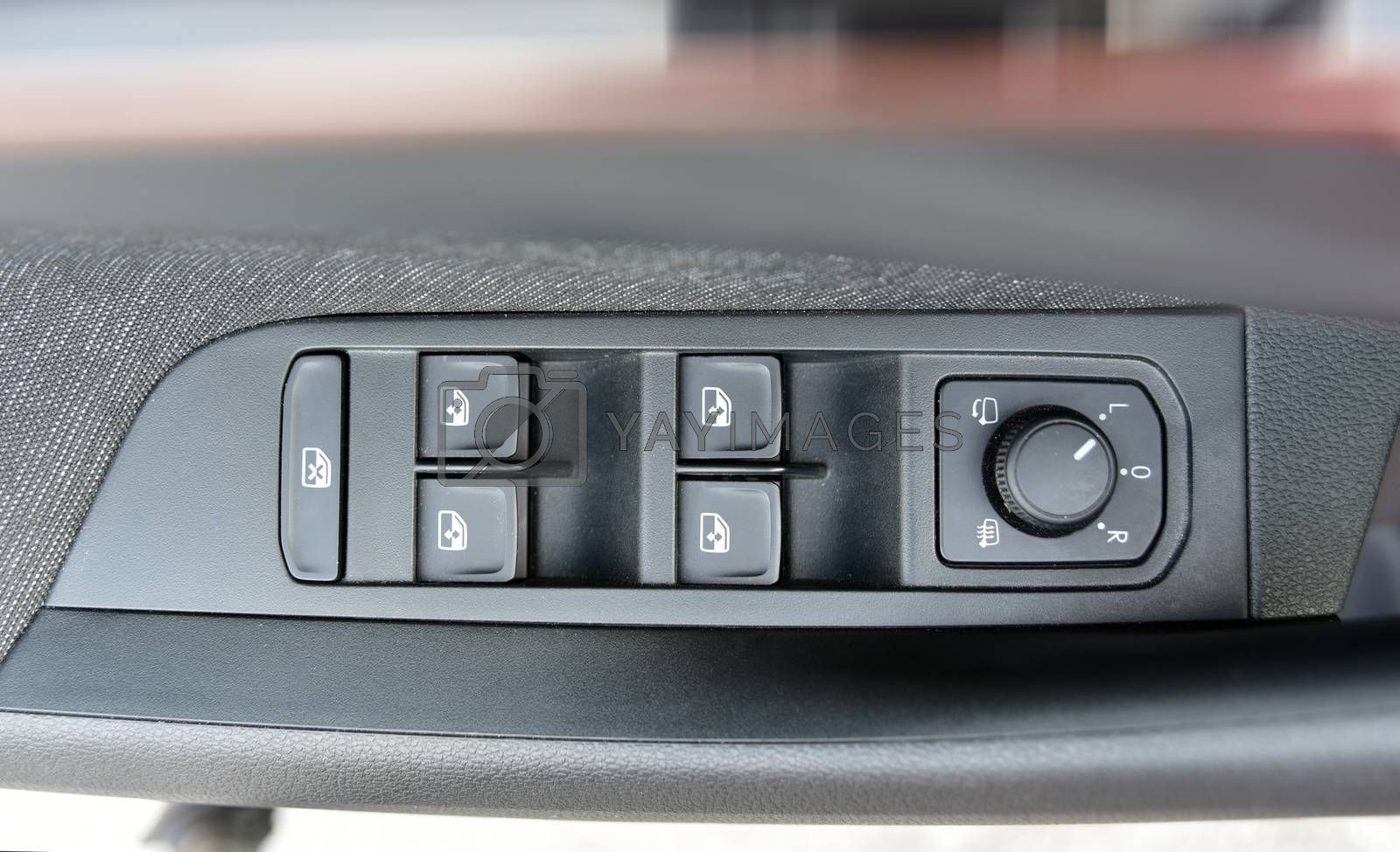 Royalty free image of Side mirror switch control and window button by aselsa