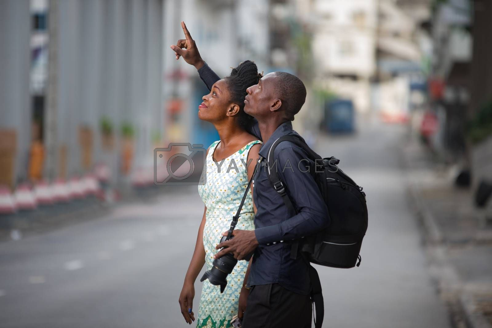 Tourist couple enjoying sightseeing and exploring city by vystek