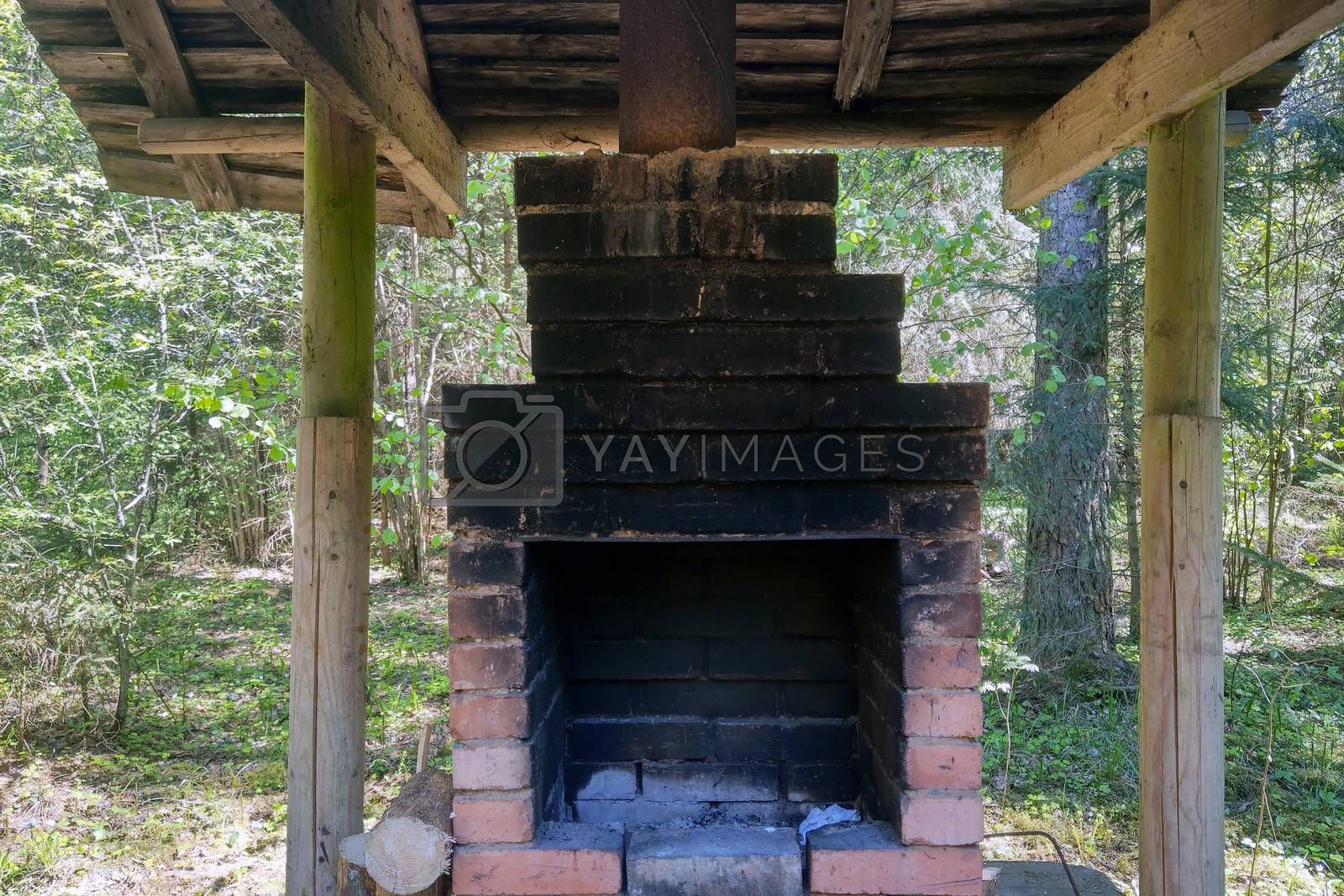 Small oven outside under a canopy for cooking