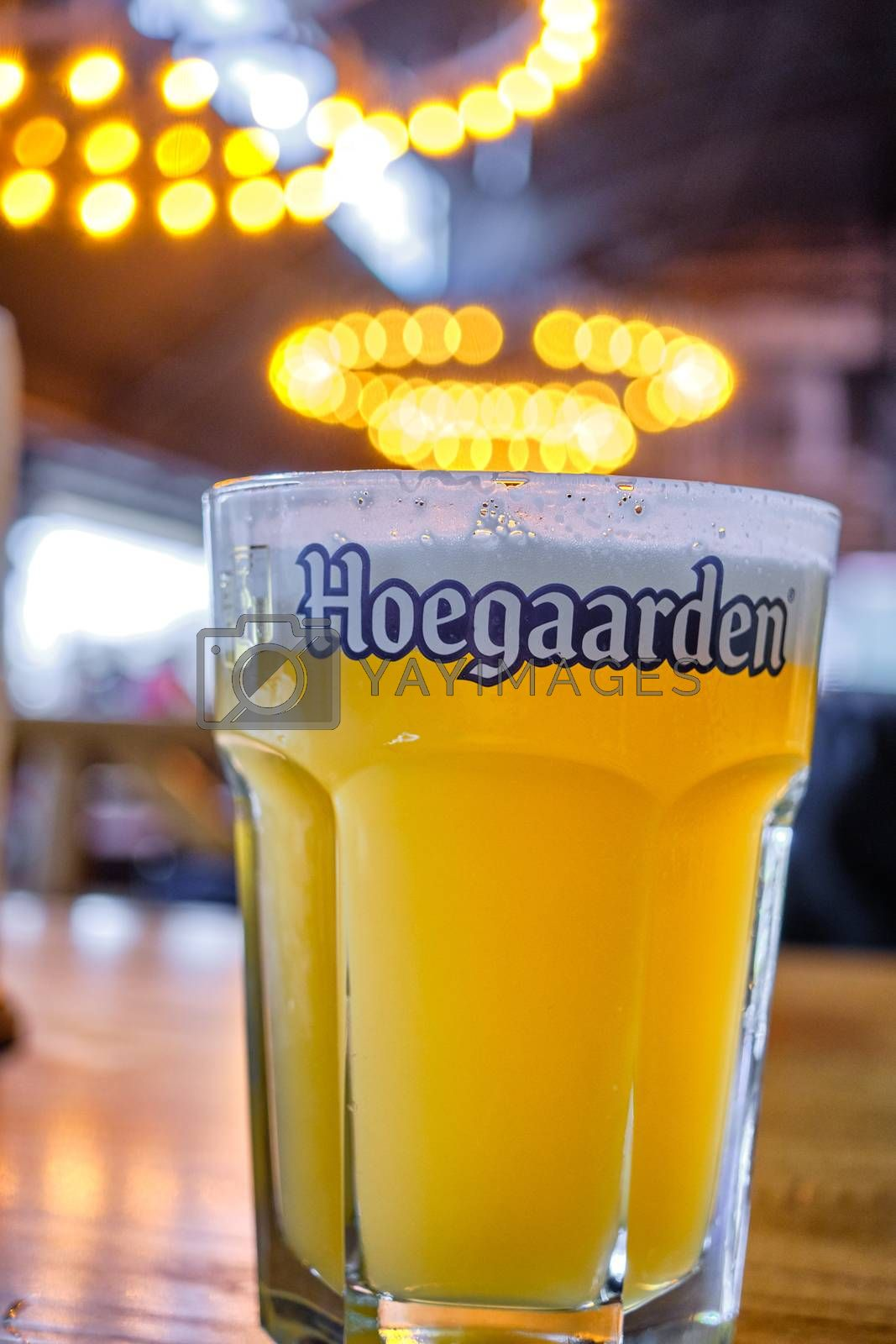 Belgrade / Serbia - November 17, 2019: Cup of Hoegaarden Belgian wheat beer on a table in a bar