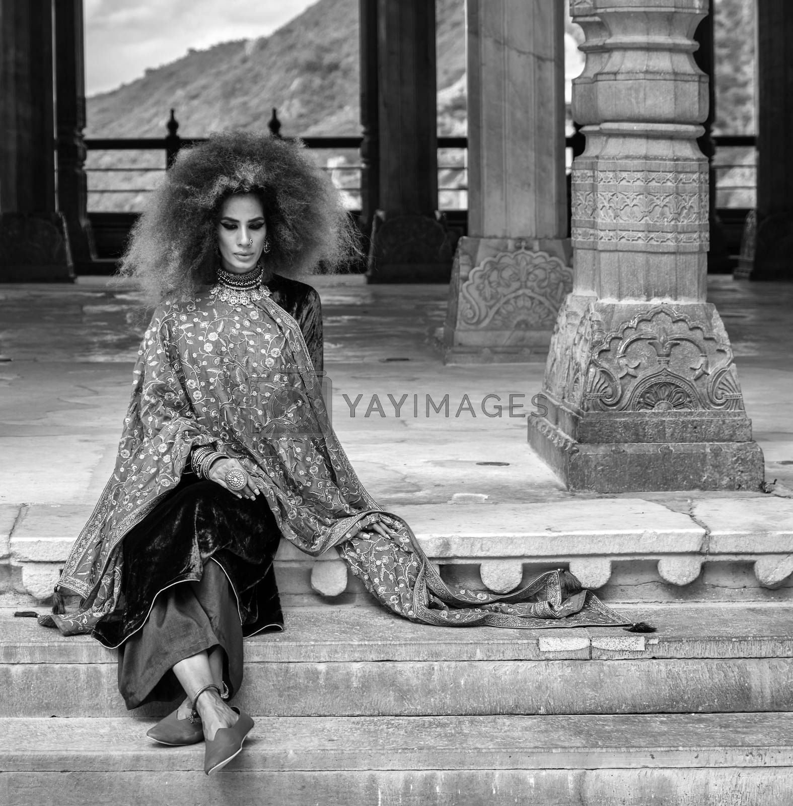 Jaipur, Rajasthan / India - September 28, 2019: Beautiful girl in traditional Indian clothing at the royal palace in the Amer Fort in Jaipur, India