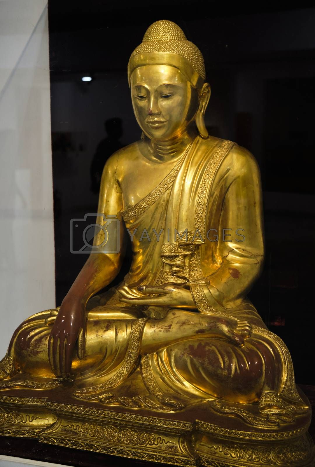 New Delhi / India - September 26, 2019: Gilded statue of a Buddha in the National Museum of India in New Delhi
