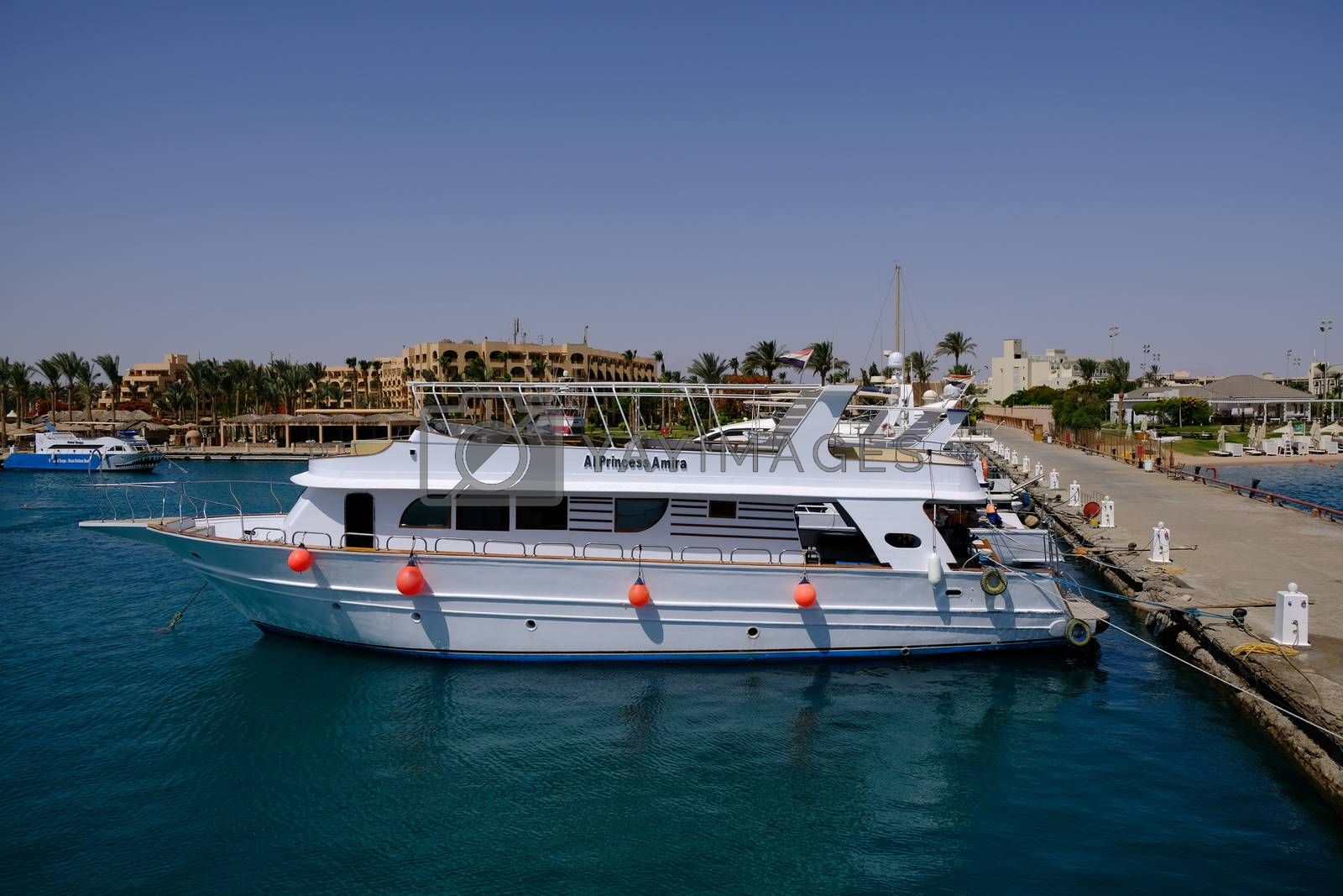 Hurghada / Egypt - May, 2019: Yachts and tourist boats in the Hurghada Marina in Hurghada, popular beach resort town along Red Sea coast of Egypt