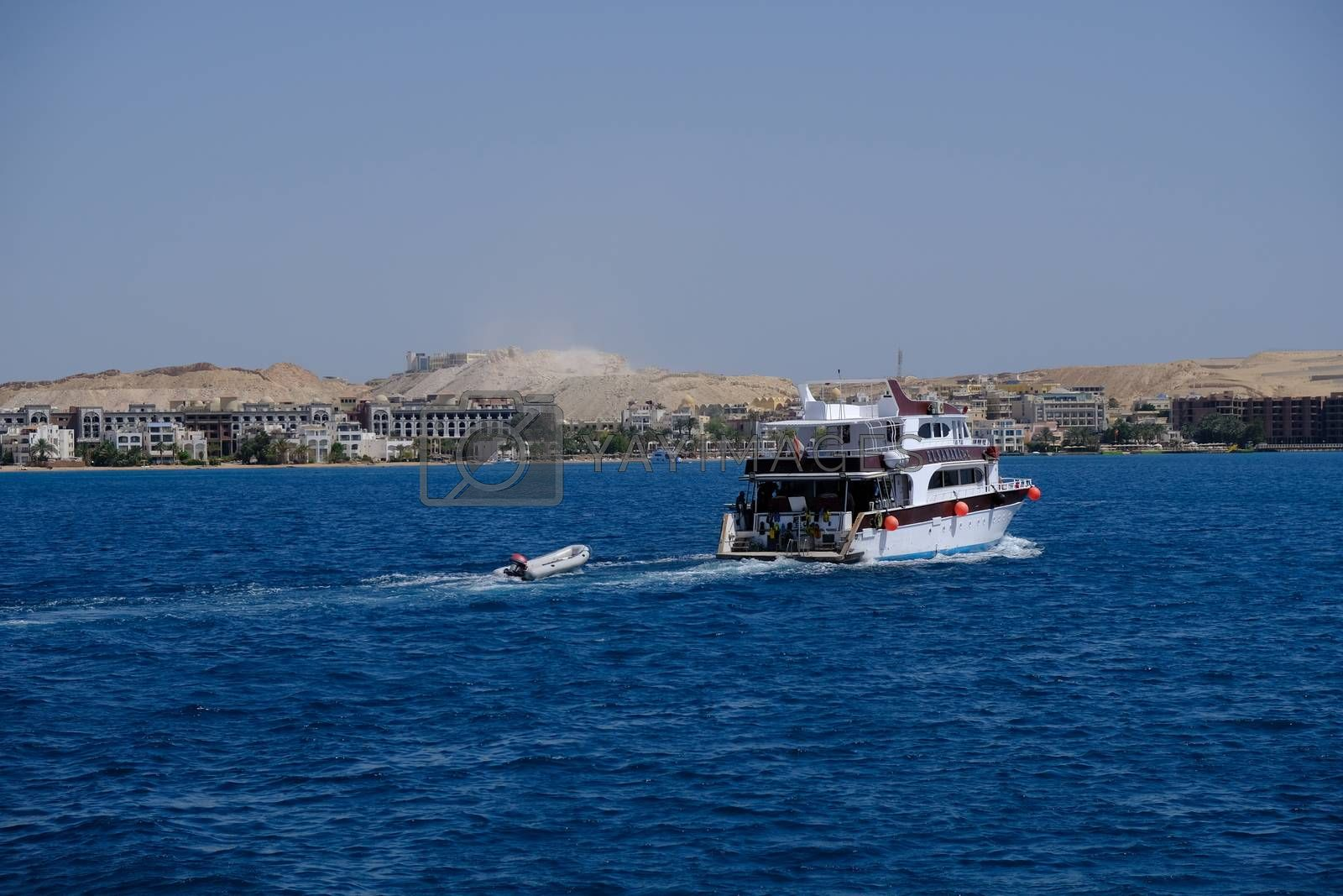 Hurghada / Egypt - May 21, 2019: Boats taking tourists for snorkeling and scuba diving near Giftun island in Red Sea, Hurghada, Egypt