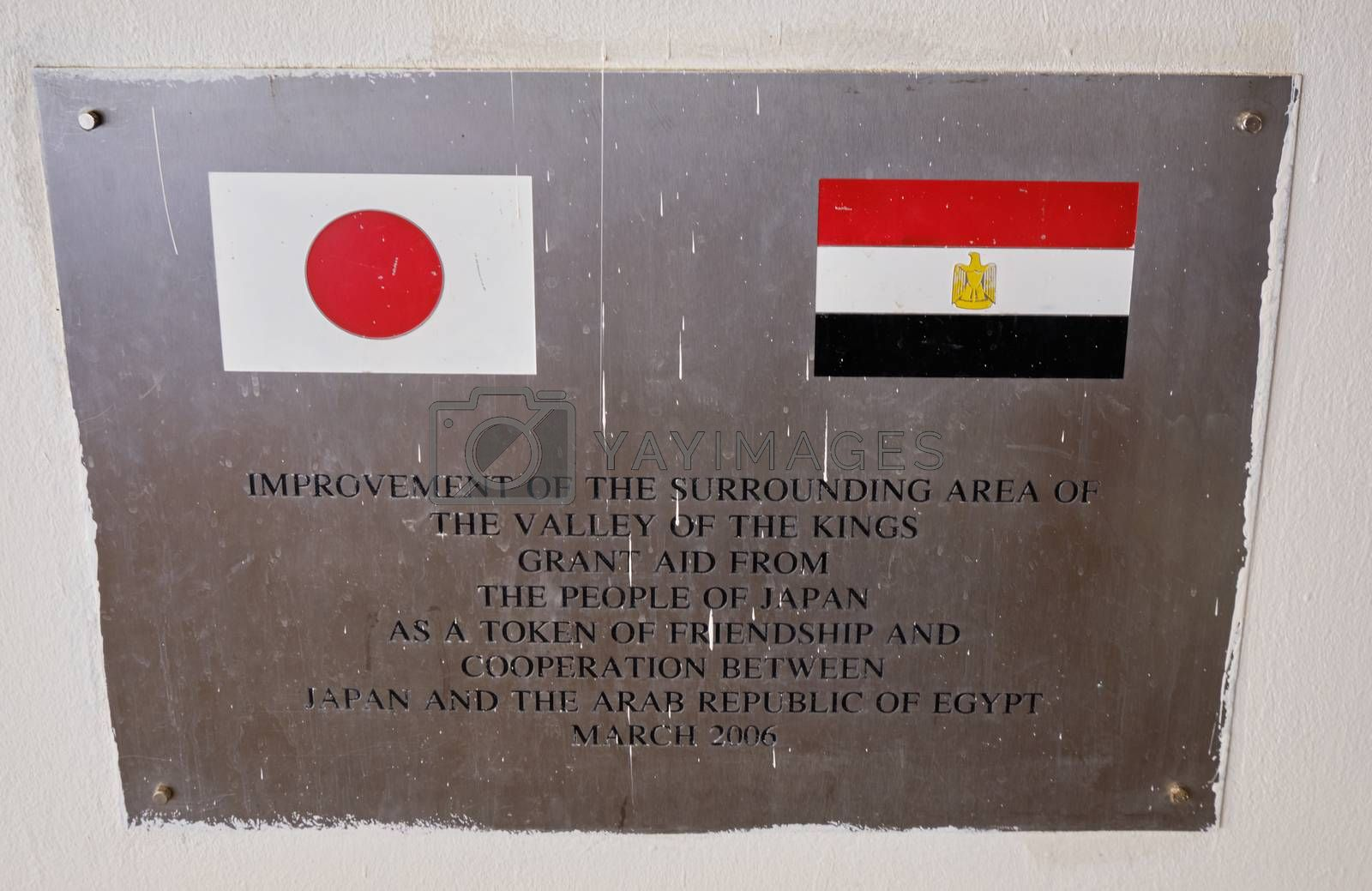 Luxor / Egypt - May 23 2019: Plaque informing about the grant aid from Japan to Egypt for restoration works of ancient Egyptian archaeological sites in the Valley of the Kings in Luxor, Egypt