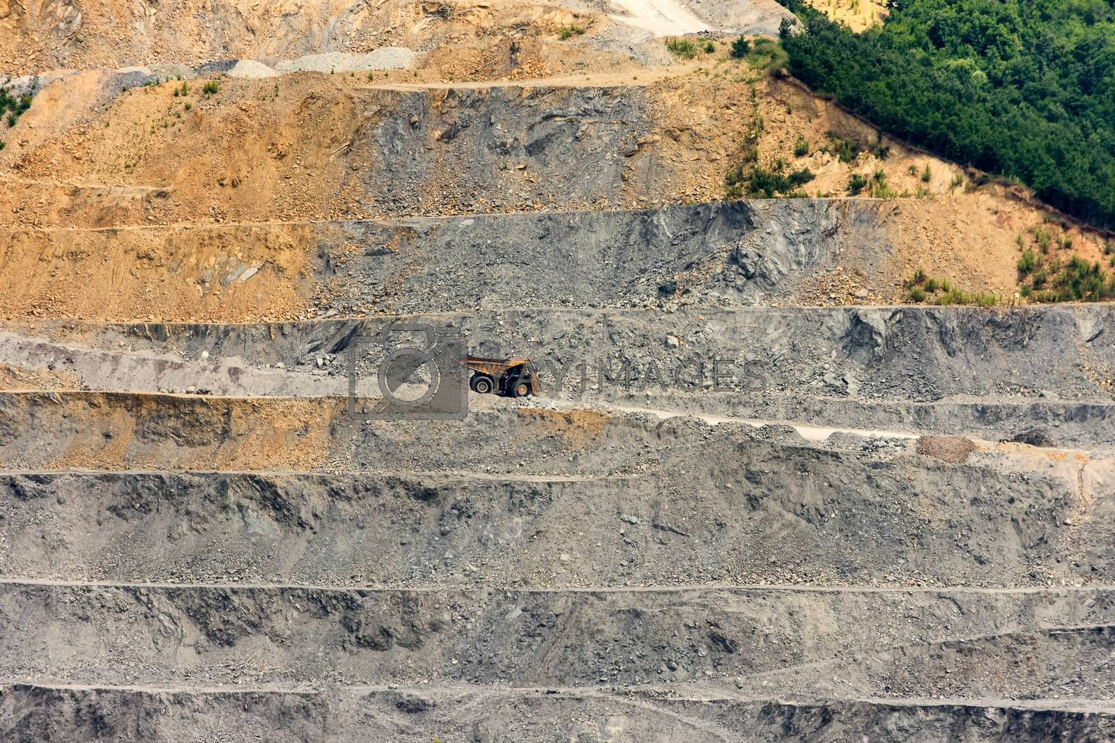 Bor / Serbia - July 13, 2019: Damper truck transporting ore in the Veliki Krivelj mine of Zijin Bor Copper, one of the largest copper mines in the world, owned by Chinese mining company Zijin Mining