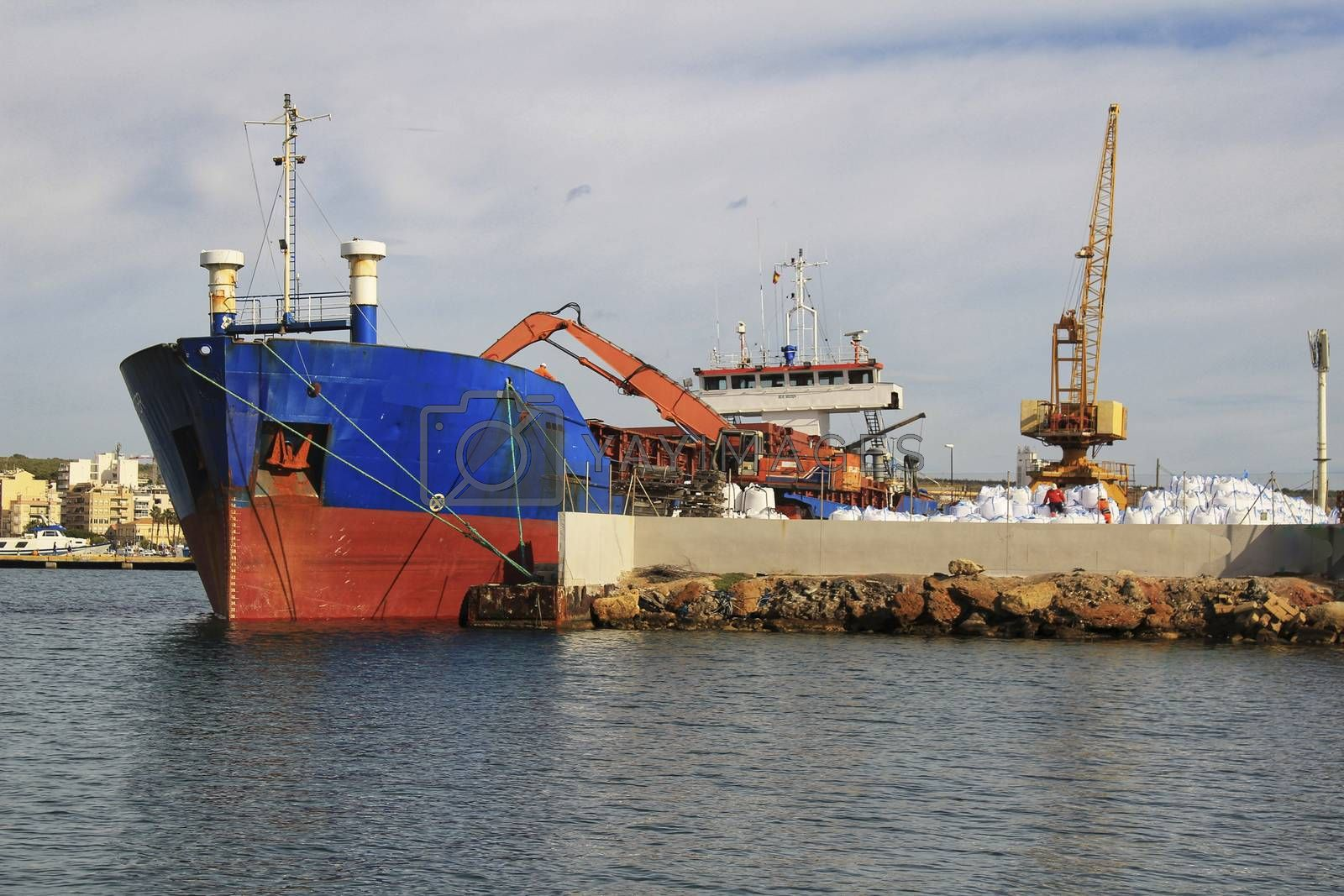 Merchant ship unloading at the dock in Santa Pola