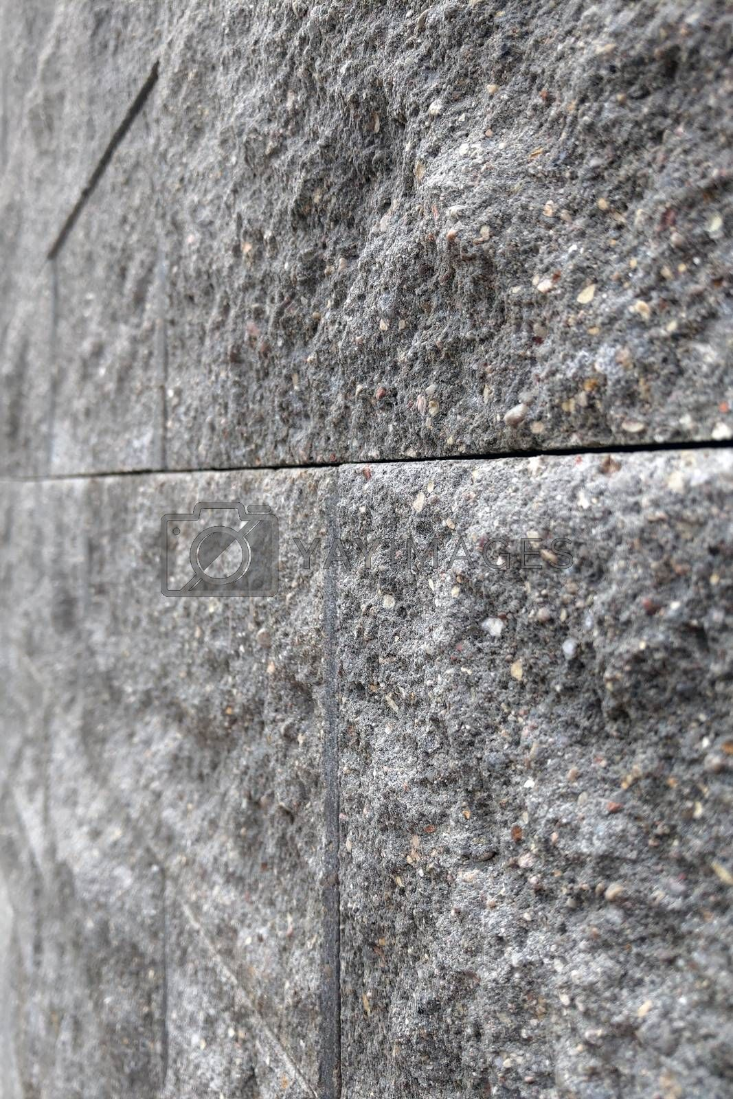 Light stone tiles on the building. Background, texture