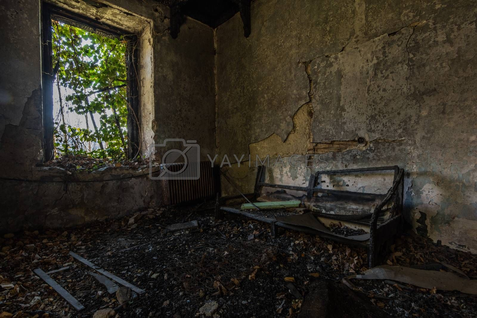dark room without window after a fire in a forest