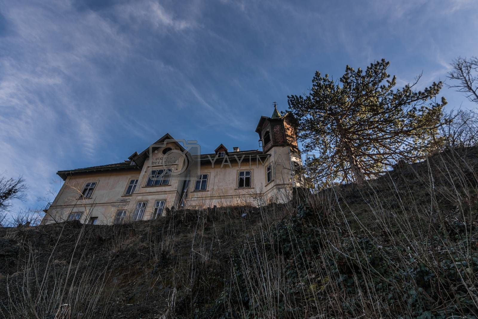 Abandoned old hotel on top of a mountain with blue sky