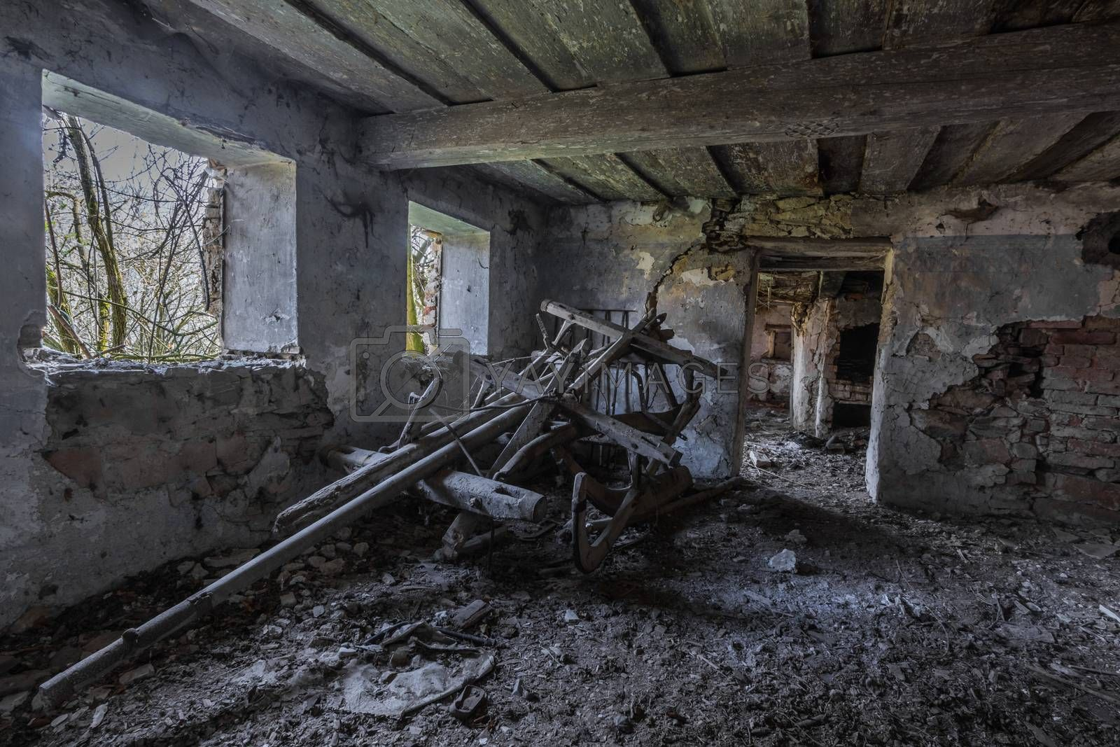 lower room of an abandoned farmhouse in the forest