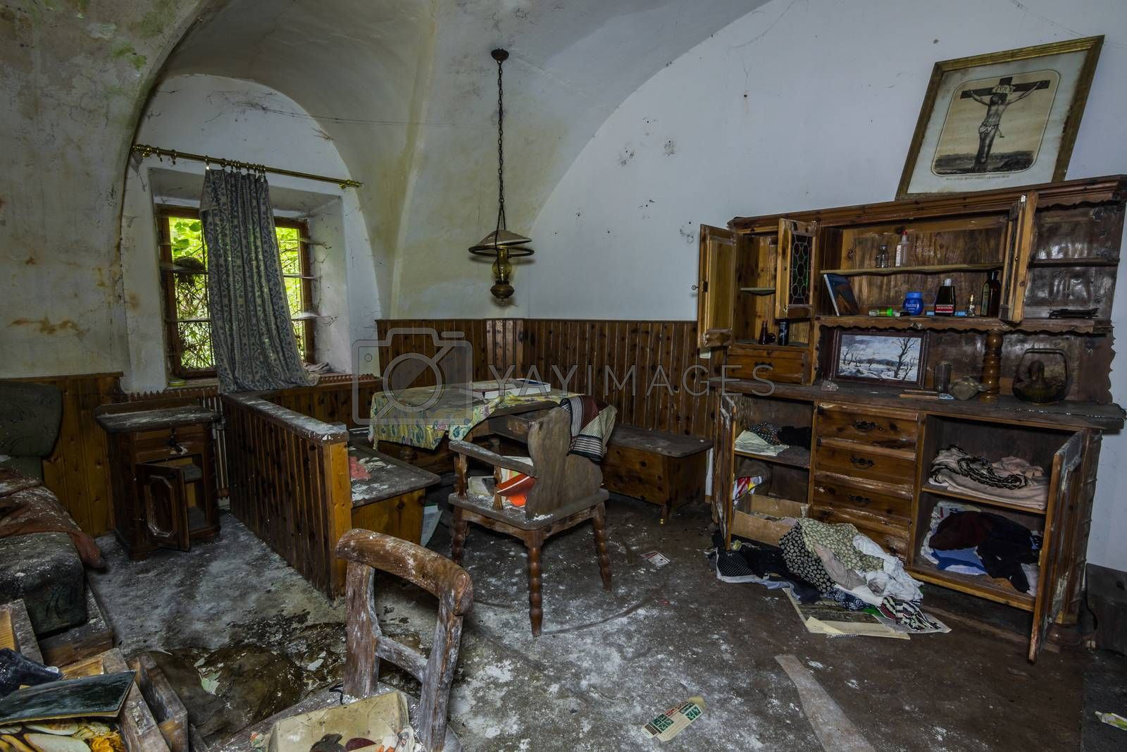 wooden furniture with mold in a room with many objects