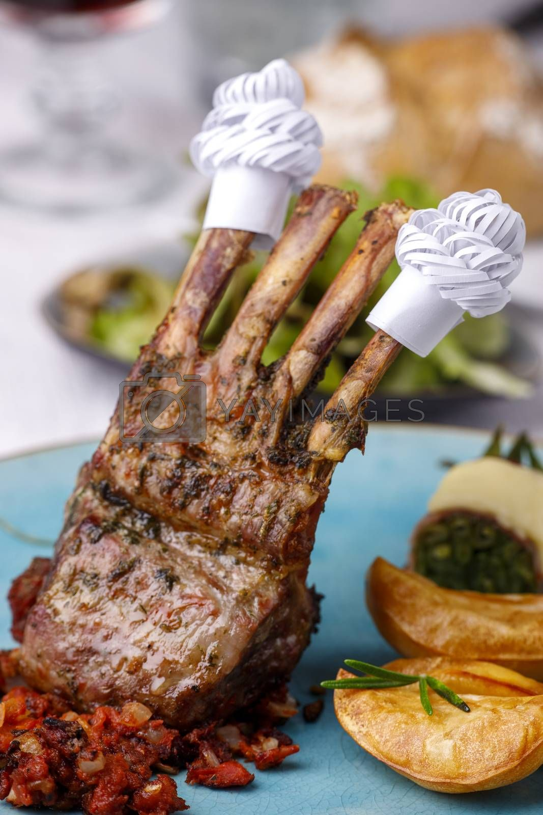 lamb ribs with frills and salad