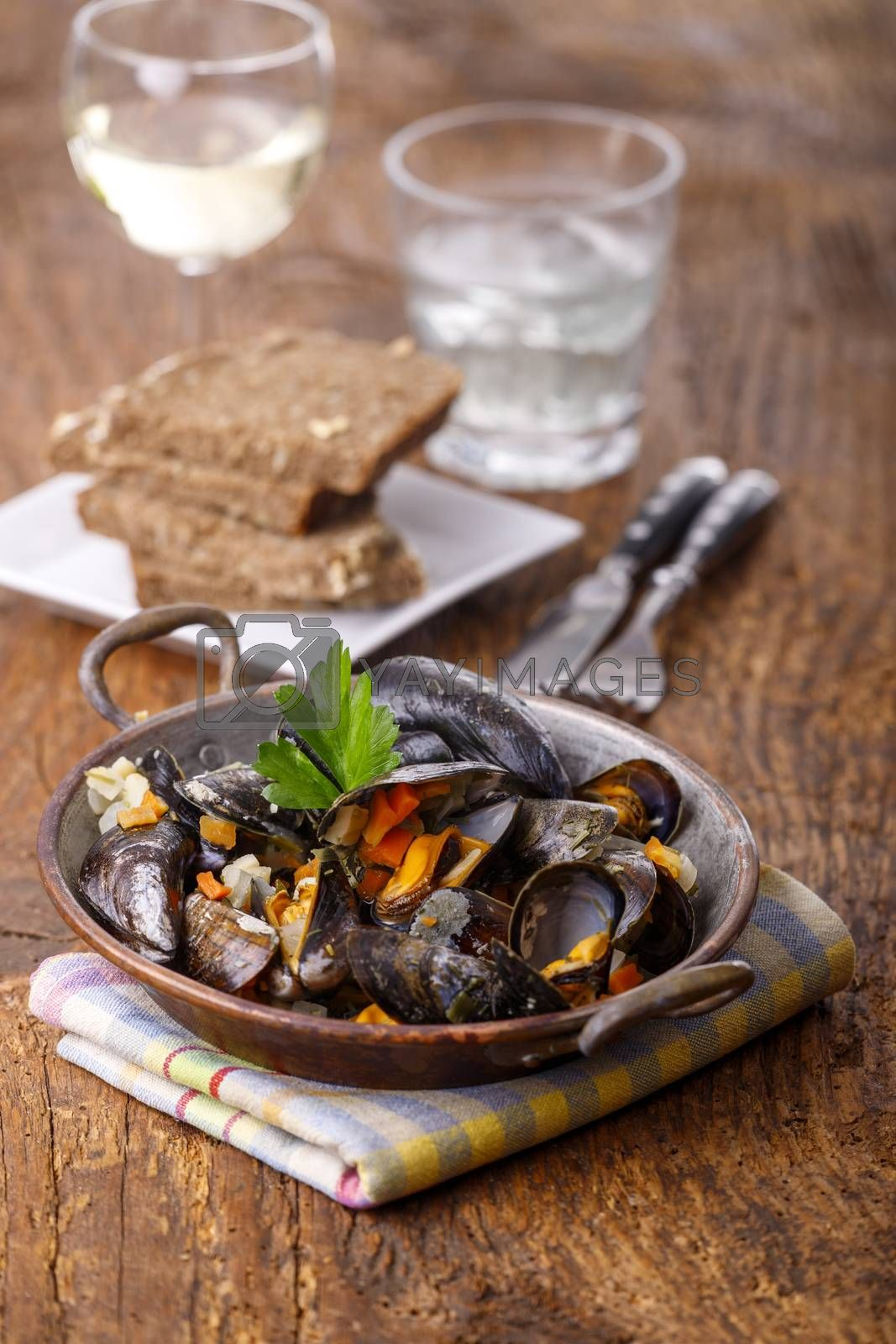cooked mussels on dark wood