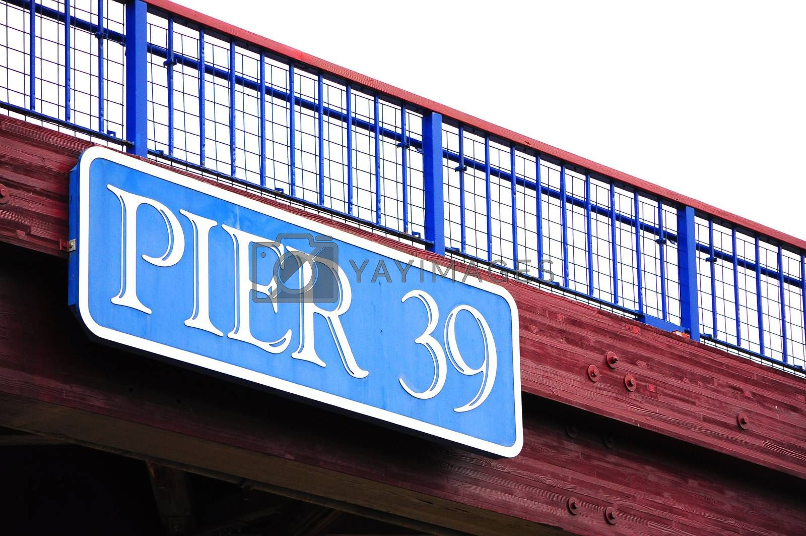 Pier 39 sign on flyover. Pier 39 is a shopping center and popular tourist attraction built on a pier, in Fisherman's Wharf in San Francisco, California.