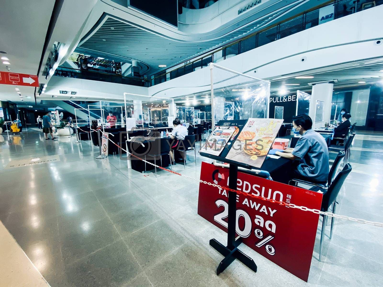 Food order booths for restaurants in shopping mall in Bangkok during COVID-19 situation. The mall adopted area during city lockdown because of coronavirus pandemic