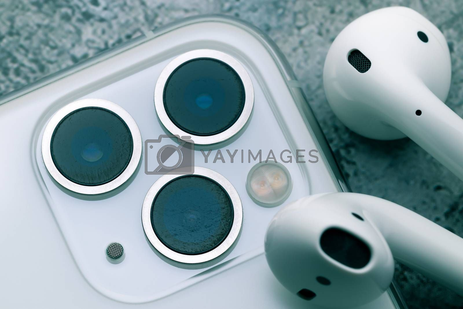 Close up shot for scratch on iPhone11 Pro Max rear camera lens, the triple camera system of ultra wide, wide and telephoto lenses. iPhone11 Pro Max and Airpods