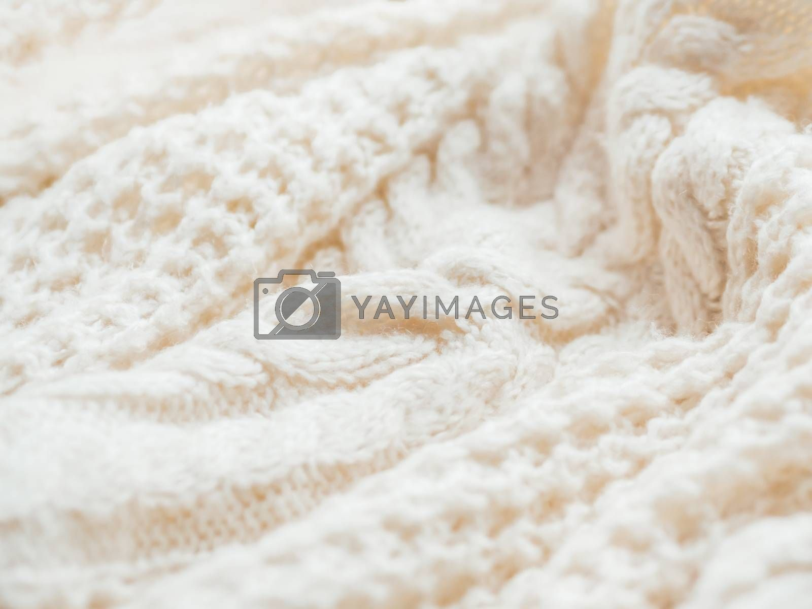 Royalty free image of Hand made cable-knit sweater sweater. Texture of warm knitted fa by aksenovko