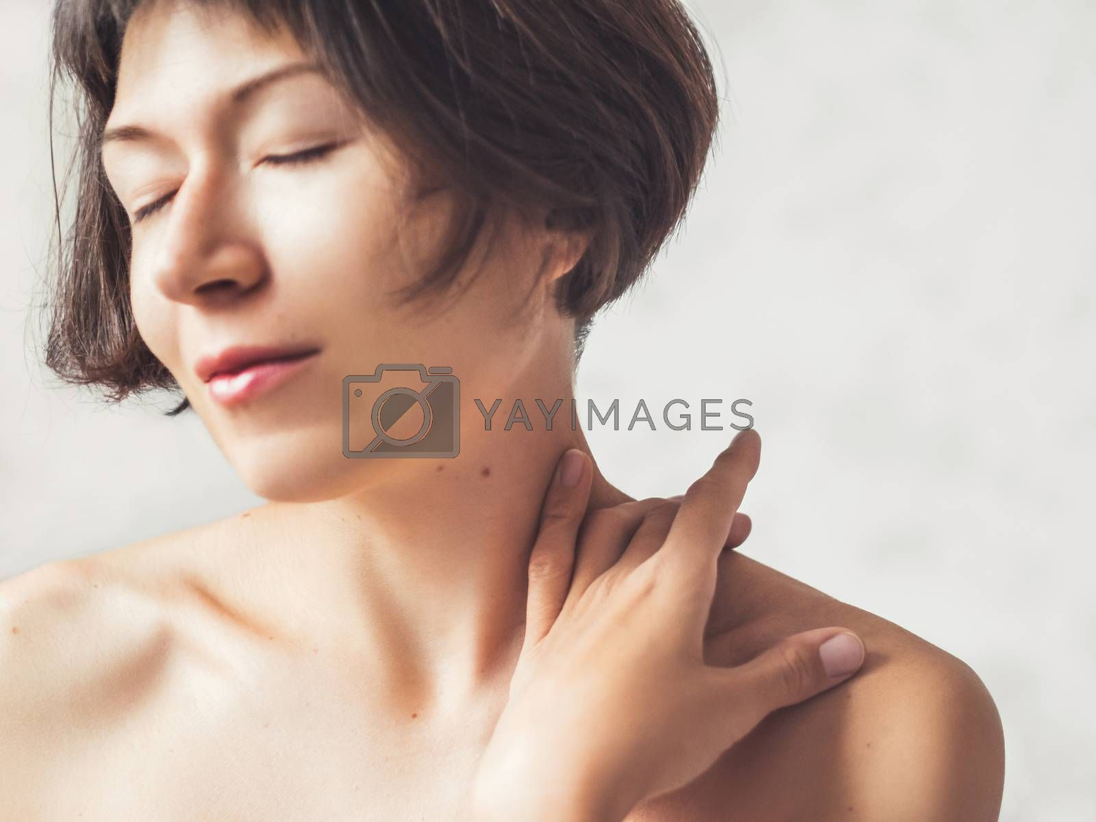 Close up portrait of woman on white background. Natural beauty without make up.