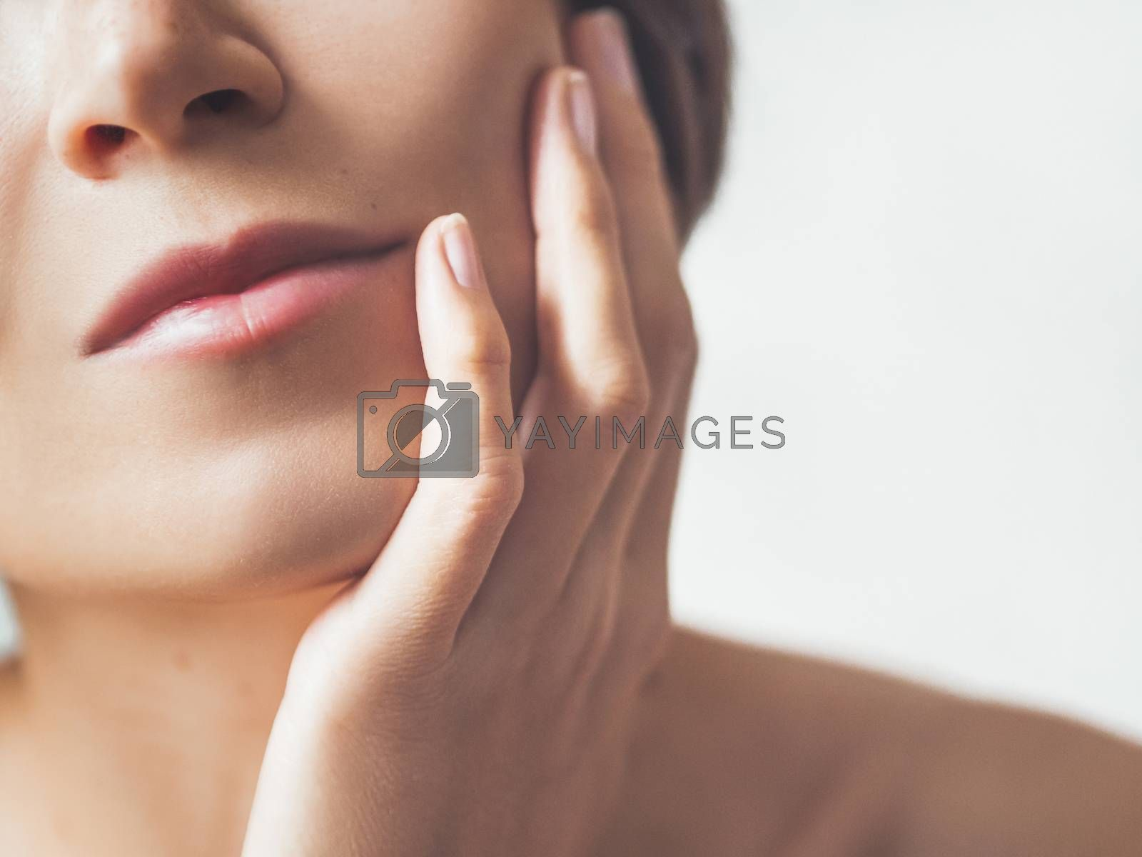 Royalty free image of Close up portrait of woman on white background. Natural beauty w by aksenovko