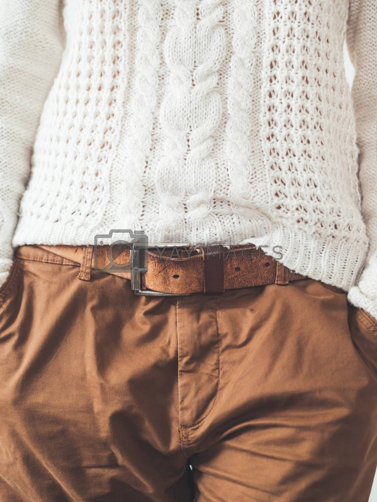 Royalty free image of Woman in cable-knit white sweater with Scandinavian patter and b by aksenovko