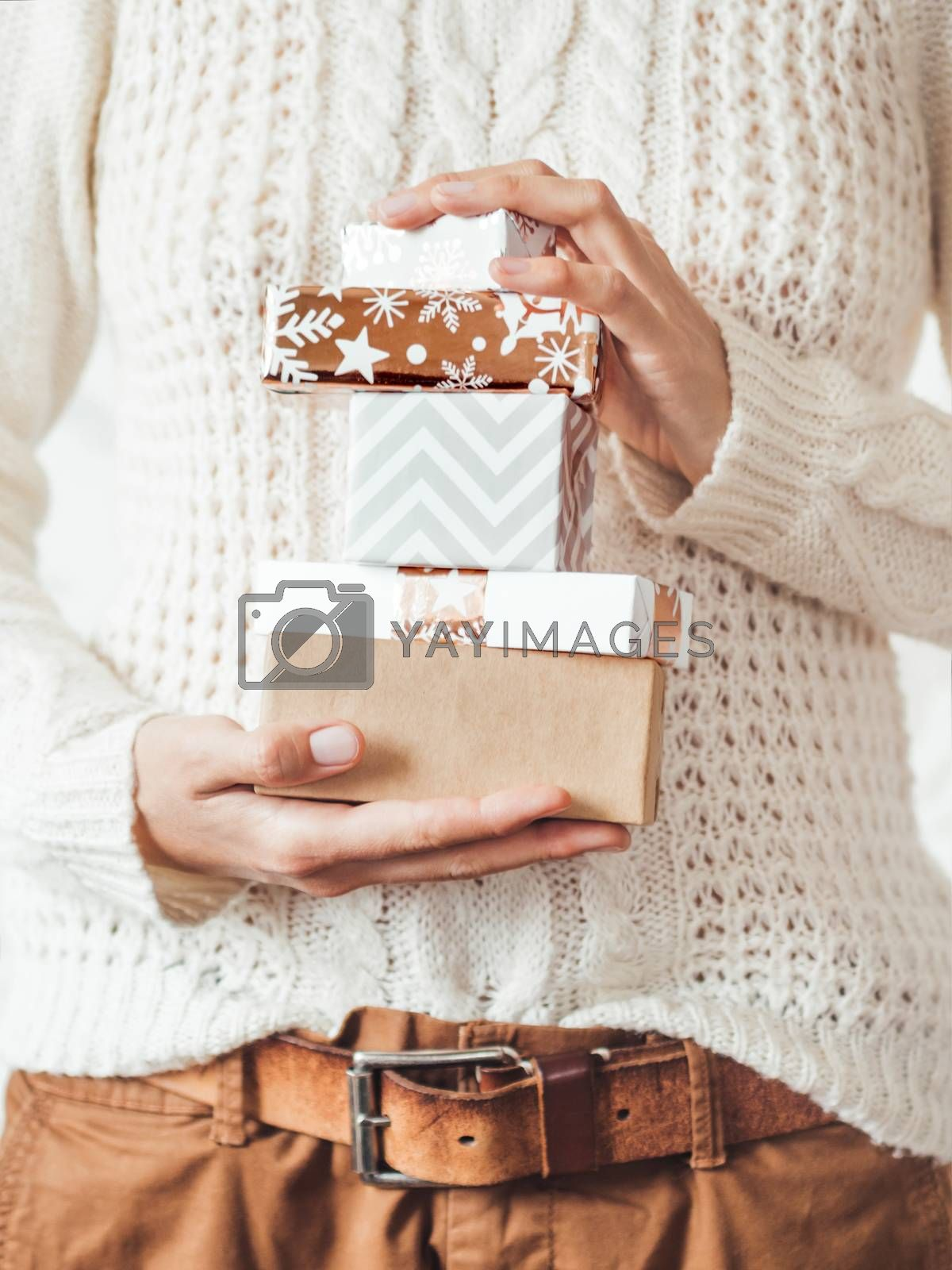 Royalty free image of Woman in cable-knit white sweater with Scandinavian pattern and  by aksenovko