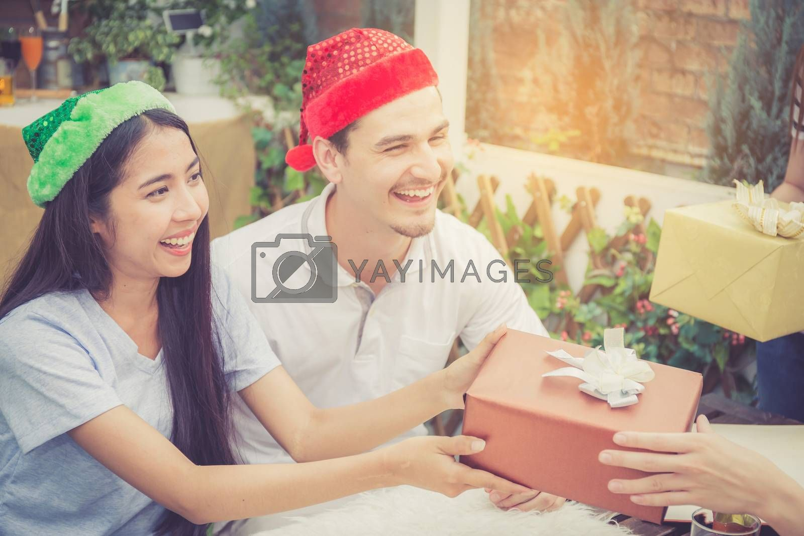 Asian group people man and woman giving gift box and celebration at party outdoor. group of friends social event with birthday achievement, festive concept.