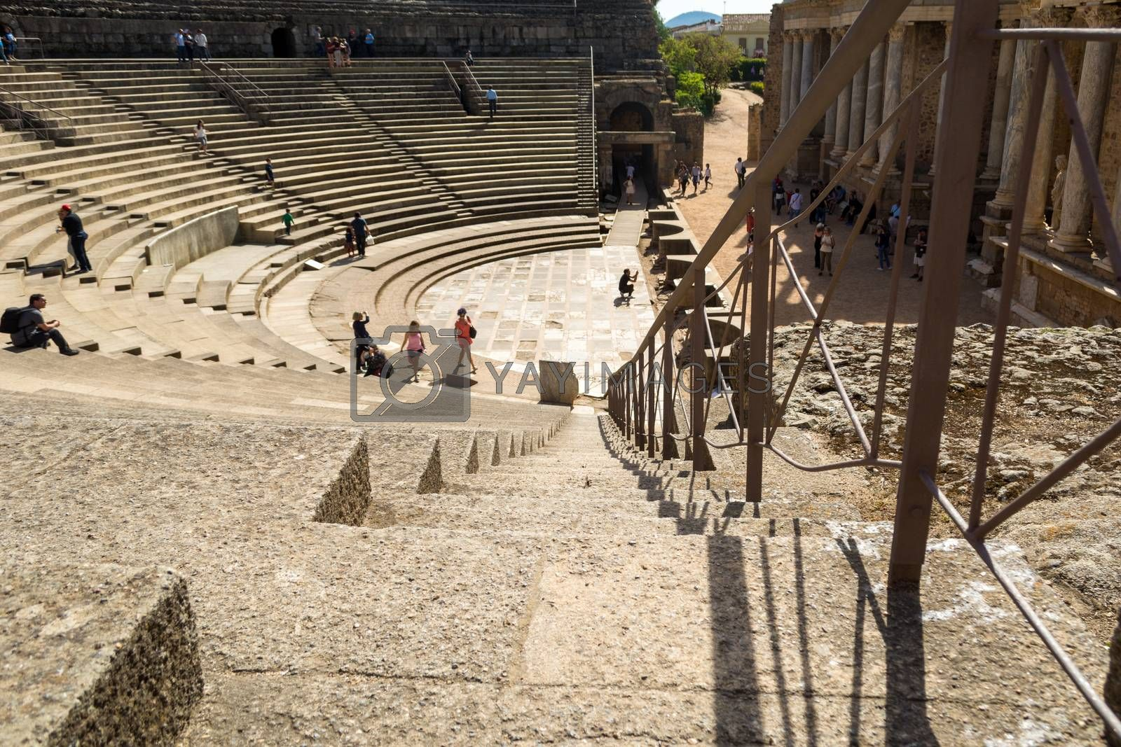 Merida, Spain, April 2017, tourists visiting the Roman ruins theatre arena & waiting rooms used for gladiator & animal fights. Travel and tourism.