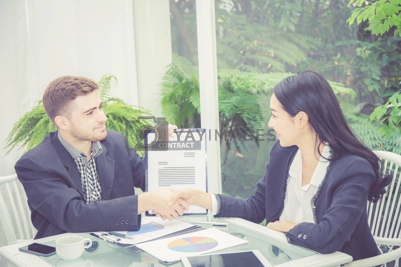 Business man and woman meeting and showing success with handshake in the office, agreement of partnership employee with together, communication concept.