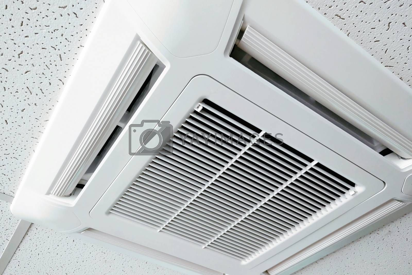 Indoor air conditioner view. Ventilation grill in the ceiling. Fresh clean air