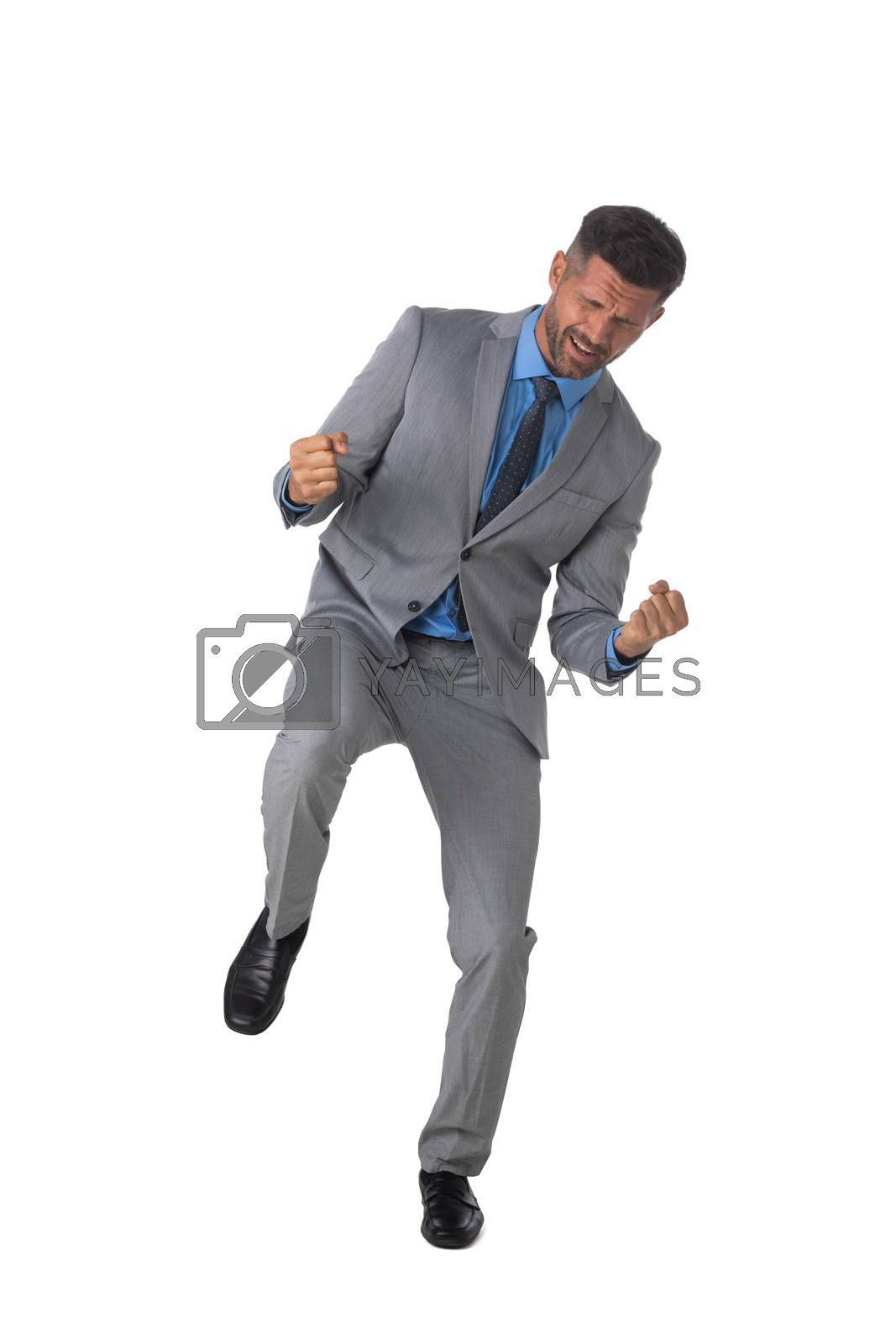 Young business man winner holding fists isolated on white background full length studio portrait