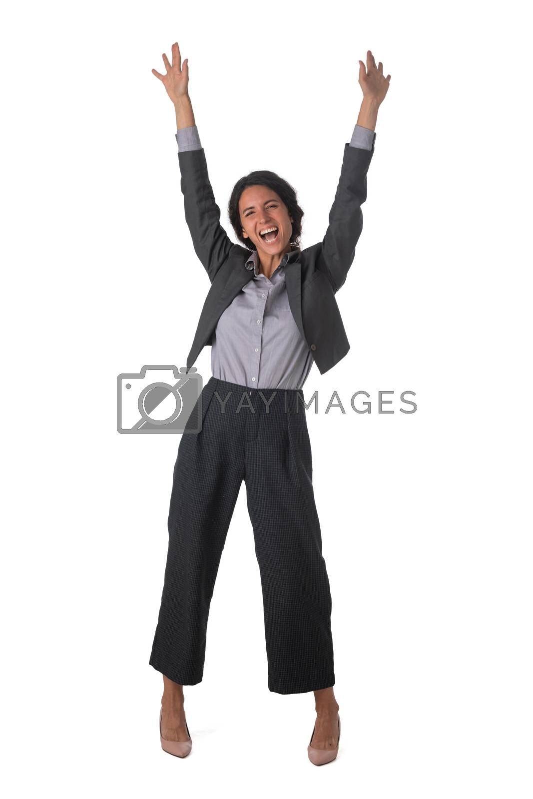Young business woman winner with arms raised isolated on white background full length studio portrait
