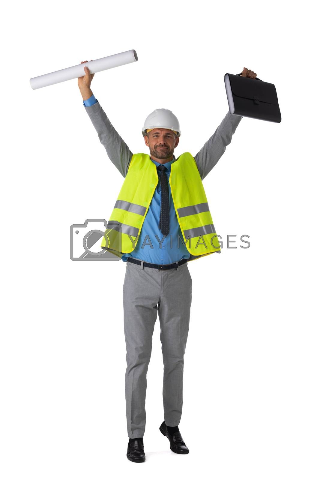 Male engeneer architect foreman in white hardhat and safety vest winner with raised arms isolated on white background full length studio portrait