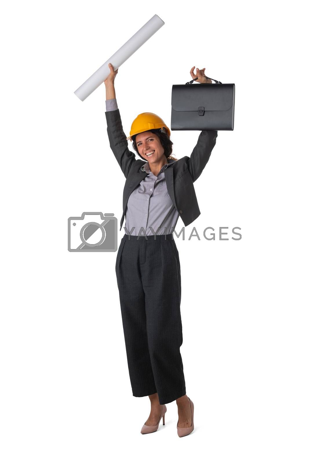 Portrait of female engeneer architect in yellow hardhat and business suit with raised arms isolated on white background full length studio portrait