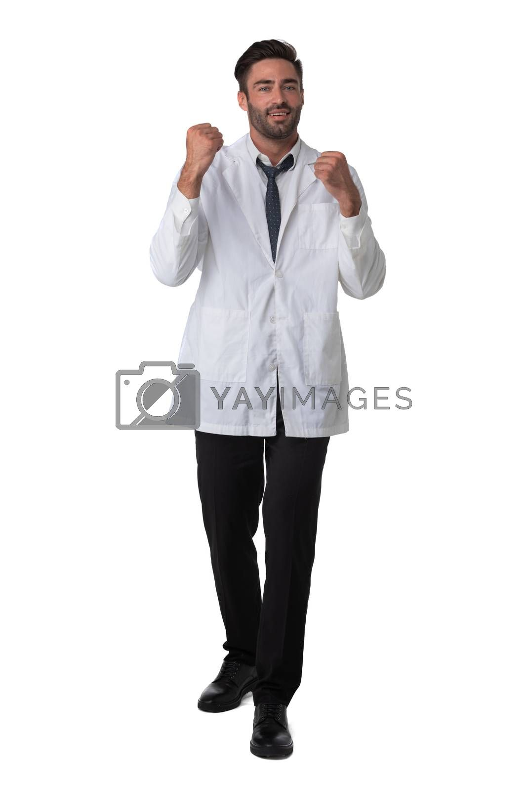 Young male medical doctor with stethoscope holding fists isolated on white background full length studio portrait