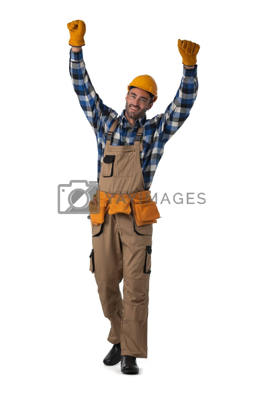 Young contractor worker in coveralls and hardhat with raised arms isolated on white background full length studio portrait