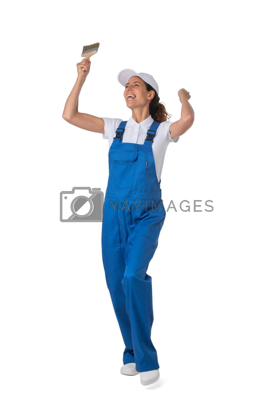 Female house painter with paint brush with raised arms isolated on white background full length studio portrait