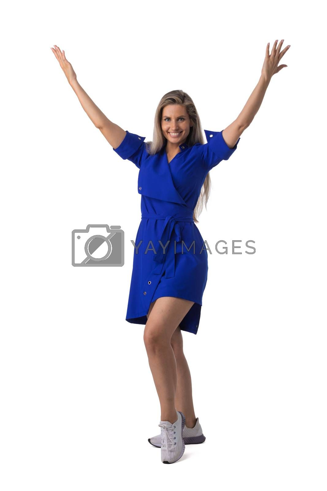 Young business woman winner with raised arms isolated on white background full length studio portrait