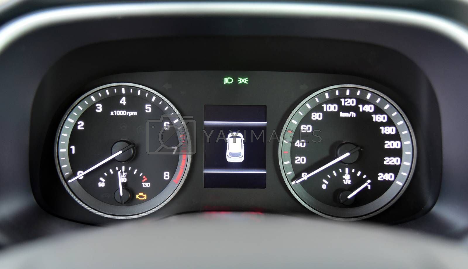 Royalty free image of Illuminated instrument panel with the passenger car by aselsa