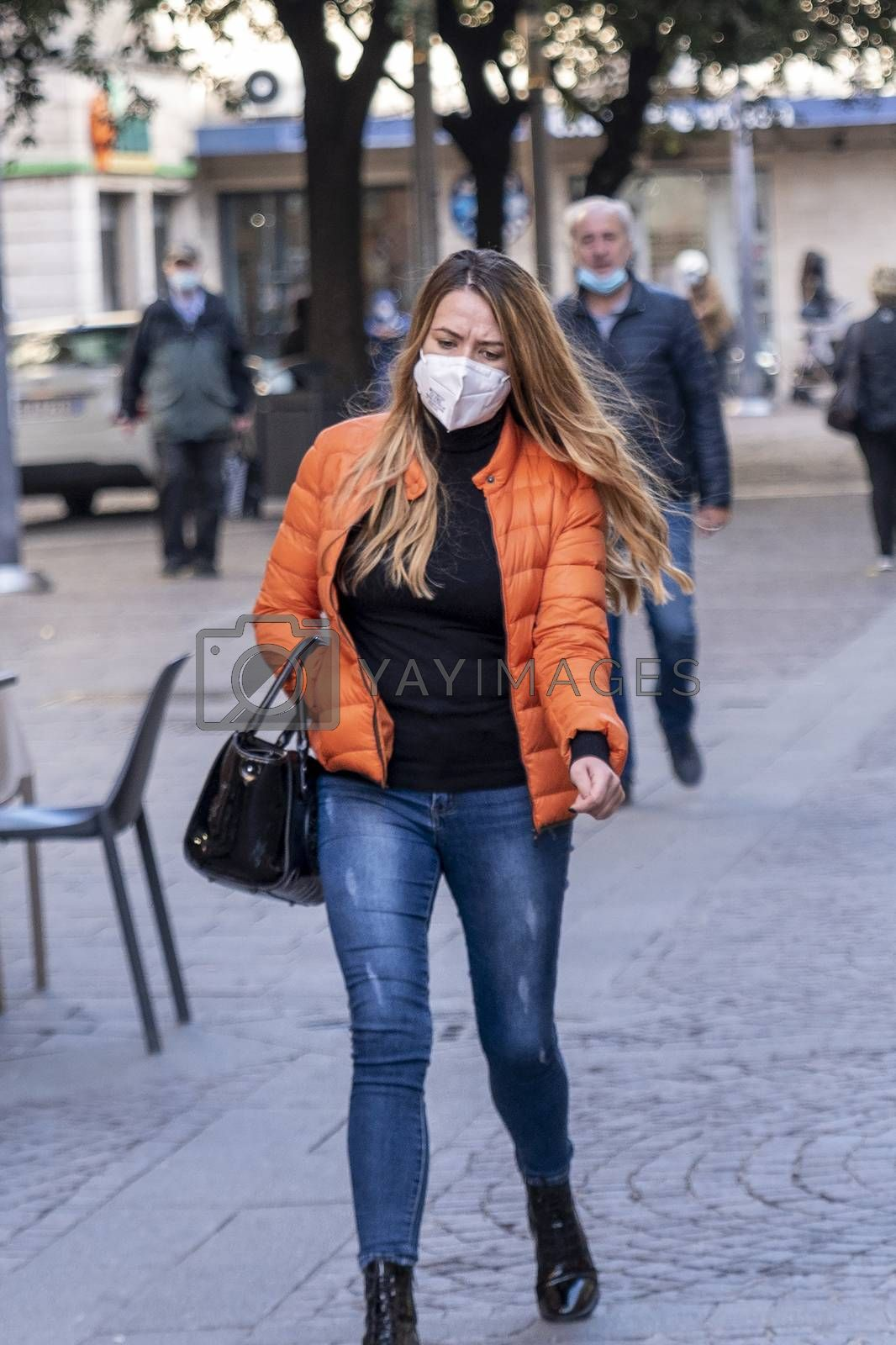 terni,italy october 21 2020:woman with medical mask walking downtown