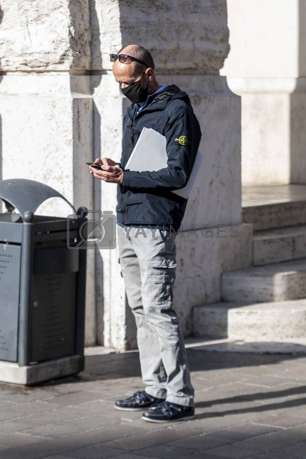 terni,italy october 21 2020:businessman looking at phone