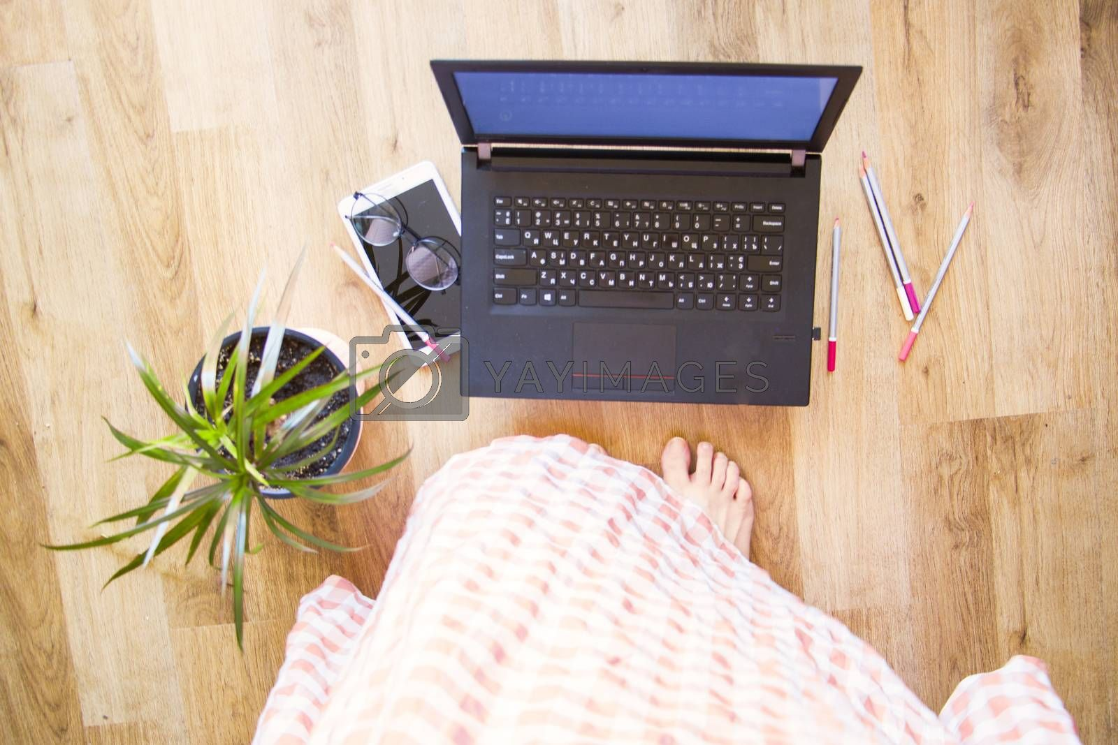 Woman working from home office, notebook or laptop, pencil and other things. Business working process, desktop and keyboard. high angle view.
