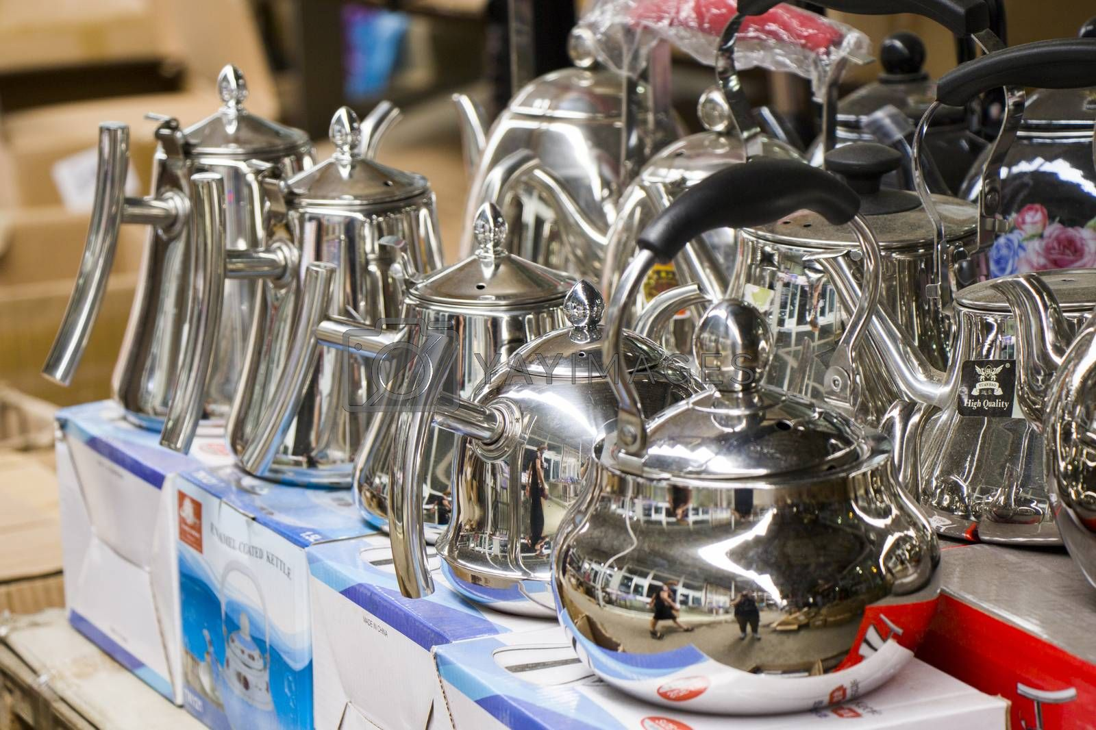 Teapot and kettle in the shop table, large group of kettles