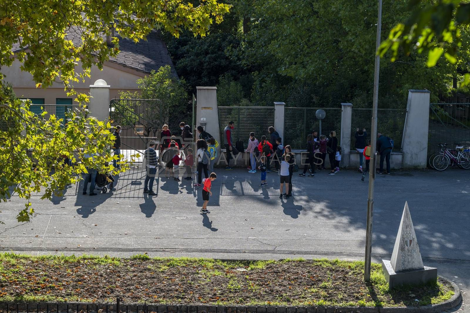 terni,italy october 21 2020:children with parents waiting to enter the school camp