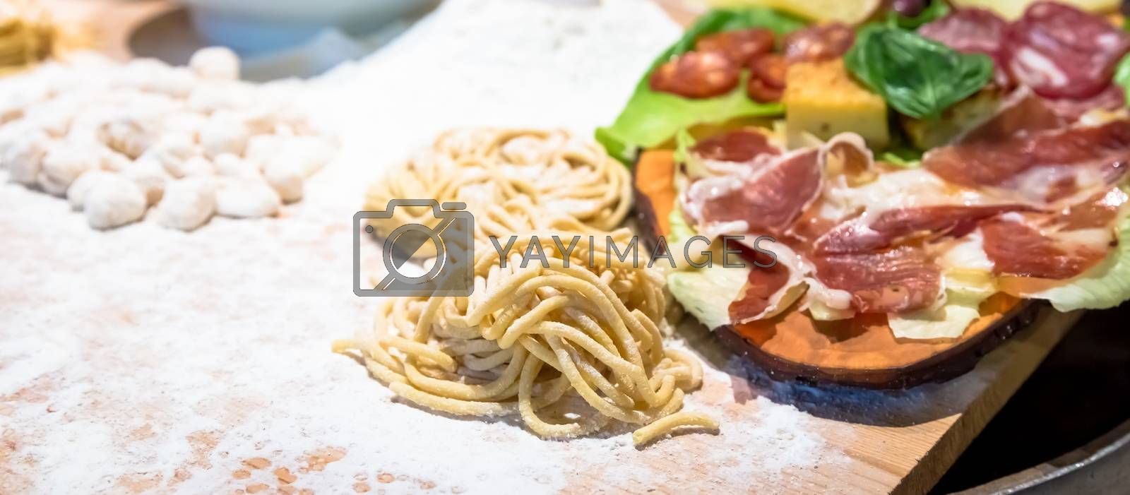 Rome, Italy. A closeup of traditional Italian cuisine. Preparation of delicious Bucatini pasta.