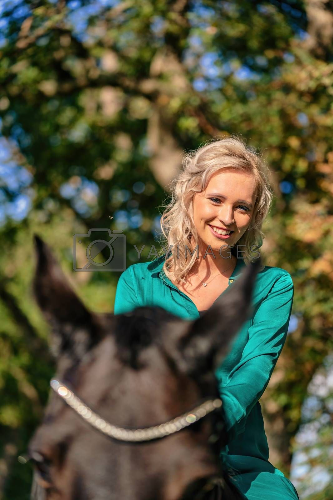 A Woman with her horse portrait at sunset, autumn outdoors scene.